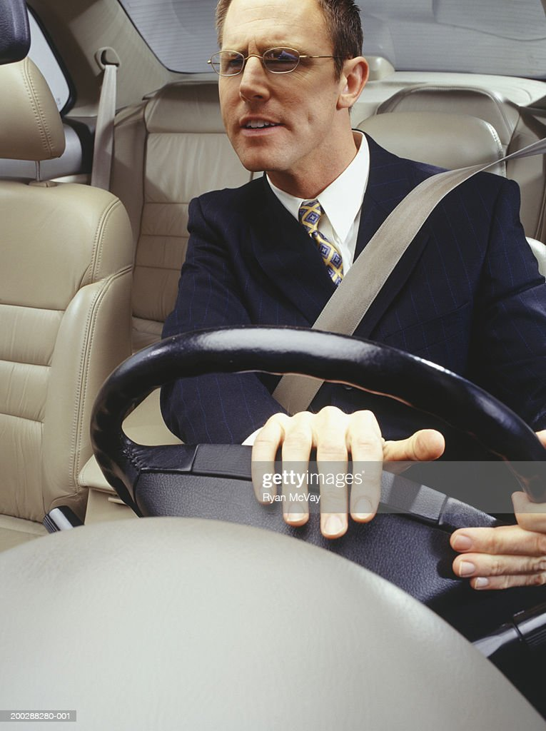 Impatient businessman pushing horn in car