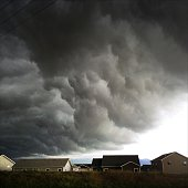 Impending thunderstorm over houses