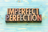 imperfect perfection word abstract in vintage letterpress wood type printing blocks