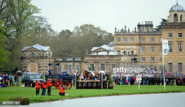 Imperial Cavalier and Mary King pass Badminton House during the cross country during Day Three of the Mitsubishi Motors Badminton Horse Trials