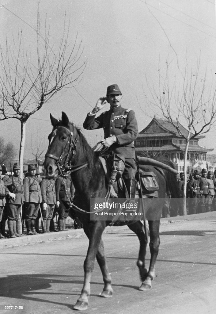 Imperial Japanese army General Iwane Matsui (1878-1948) pictured on horseback, entering Nanking during the Second Sino-Japanese War, in December 1938.