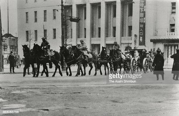 Imperial Japanese Army soldiers on horsebacks patrol as the security in Tokyo is on high alert during the February 26 1936 in Tokyo Japan