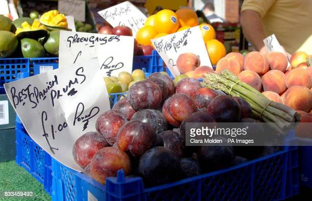 Imperial measurements such as pounds and half pounds are seen on signs indicating prices on a fruit and vegetable stall on Strutton Ground in central...