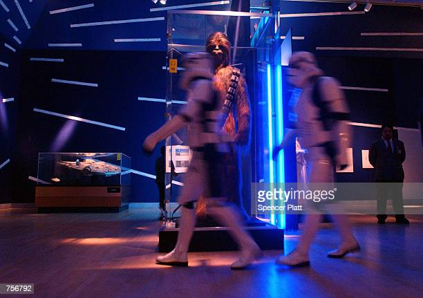Imperial Storm Troopers walk the floor April 4 2002 at the exhibit 'Star Wars The Magic of the Myth' at the Brooklyn Museum of Art in Brooklyn New...