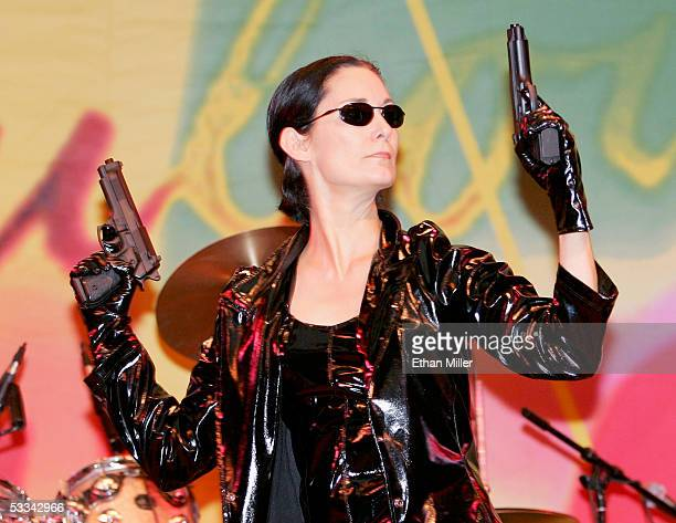 Impersonator Deborah Smith Ford performs as actress CarrieAnn Moss' Trinity character from 'The Matrix' movies during the International Guild of...