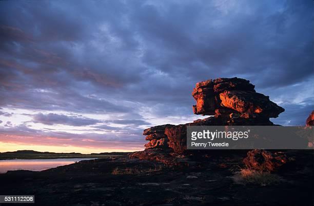 Important aboriginal site Wulk rock on the East Alligator river western Arnhem Land at sunset