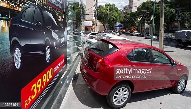 Imported cars made by Chinese carmaker JAC Motors are on display at an auto dealer's on September 16 2011 in Rio de Janeiro Brazil The Brazilian...
