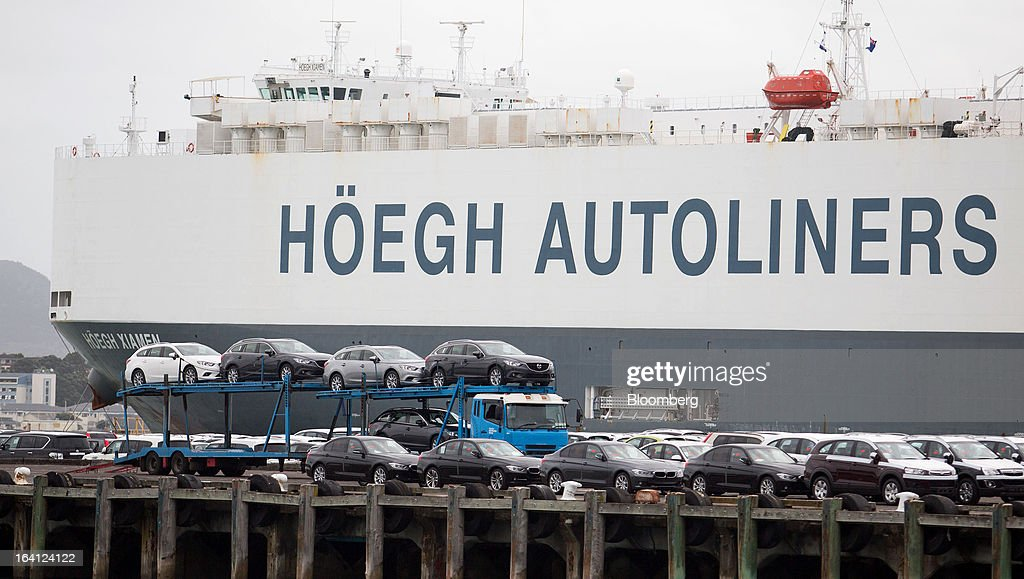Imported vehicles are unloaded from the Hoegh Xiamen cargo ship, operated by Hoegh Autoliners AS, at a Ports of Auckland terminal in Auckland, New Zealand, on Tuesday, March 19, 2013. The New Zealand dollar, nicknamed the kiwi, fell against most major peers as the government said the country's most widespread drought in at least 30 years reduces pressure to raise interest rates. Photographer: Brendon O'Hagan/Bloomberg via Getty Images