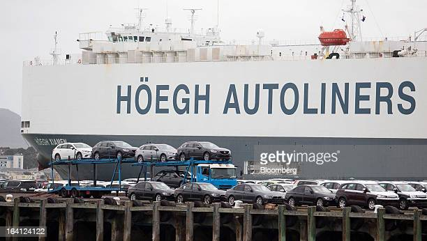 Imported vehicles are unloaded from the Hoegh Xiamen cargo ship operated by Hoegh Autoliners AS at a Ports of Auckland terminal in Auckland New...