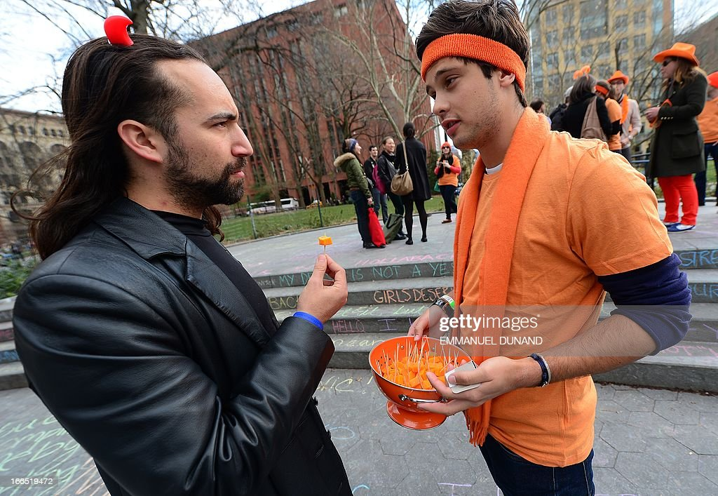 Importers and supporters offers samples of French cheese Mimolette to pedestrians during an event to support the import in the US of the 17th century-old cheese, after the US Food and Drug Administration (FDA) blocked the cheese to enter the territory, during an event in New York, April 13, 2013. The FDA, blocked the import of Mimolette on the ground that the cheese was infested with microscopic cheese mites on the surface, which can cause allergic reactions. AFP PHOTO/Emmanuel Dunand