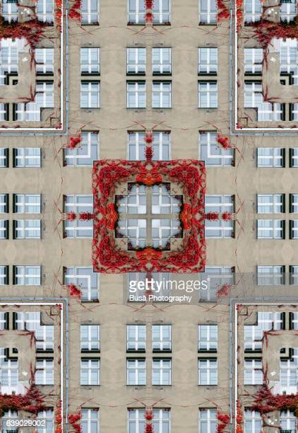 Impossible architecture: kaleidoscopic image of grey facade of a residential building in Berlin, Germany