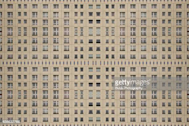Impossible architectures: digital manipulation of rows of windows of an unrenovated Plattanbau building in Berlin Mitte, close to Alexanderplatz