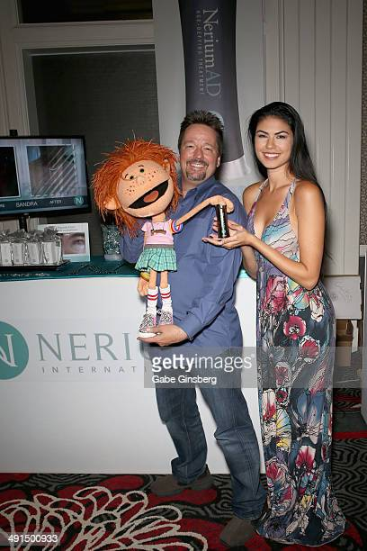 Impressionist Terry Fator and Taylor Makakoa pose with Nerium International at the 2014 Billboard Music Awards Artist Appreciation Lounge at the MGM...