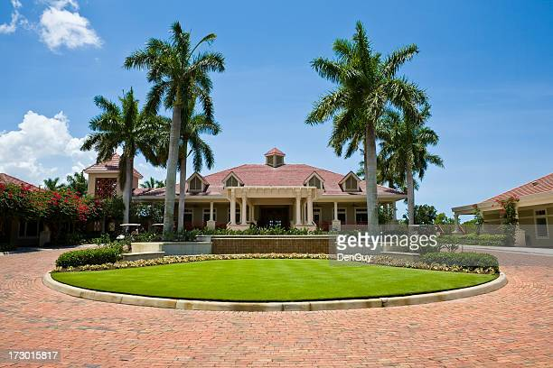 Impressive Clubhouse With Brick Driveway Florida Golf Community Wide Angle