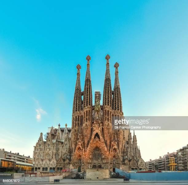 Impressive facade of Sagrada Familia basilica at early sunset in Barcelona, Catalonia, Spain