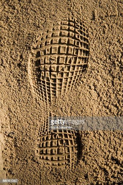 Imprint of a shoe on sand