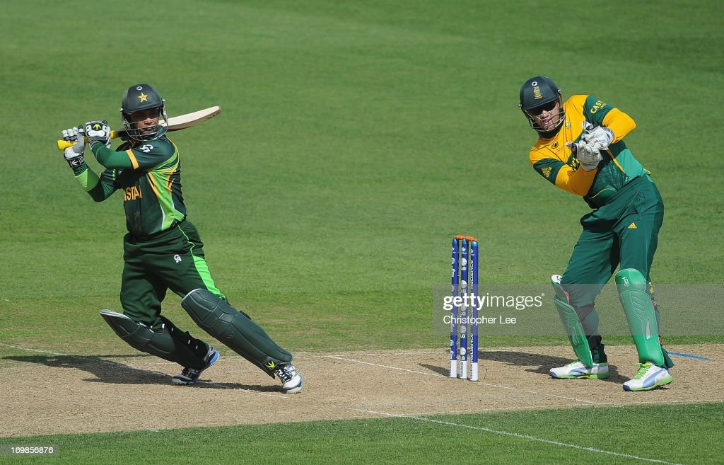Imran Farhat of Pakistan in action as AB de Villiers of South Africa watches during the ICC Champions Trophy Warm Up match between South Africa and Pakistan at The Oval on June 3, 2013 in London, England.