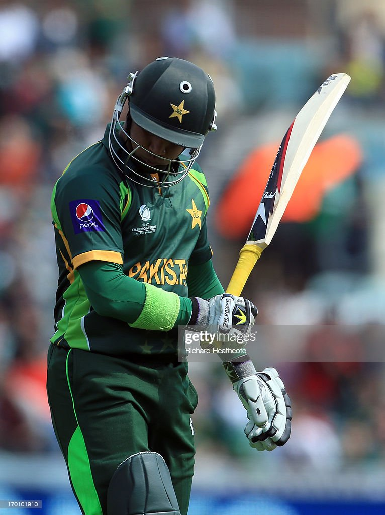 <a gi-track='captionPersonalityLinkClicked' href=/galleries/search?phrase=Imran+Farhat&family=editorial&specificpeople=585131 ng-click='$event.stopPropagation()'>Imran Farhat</a> of Pakistan walks off after losing his wicket during the ICC Champions Trophy group B match between West Indies and Pakistan at The Oval on June 7, 2013 in London, England.