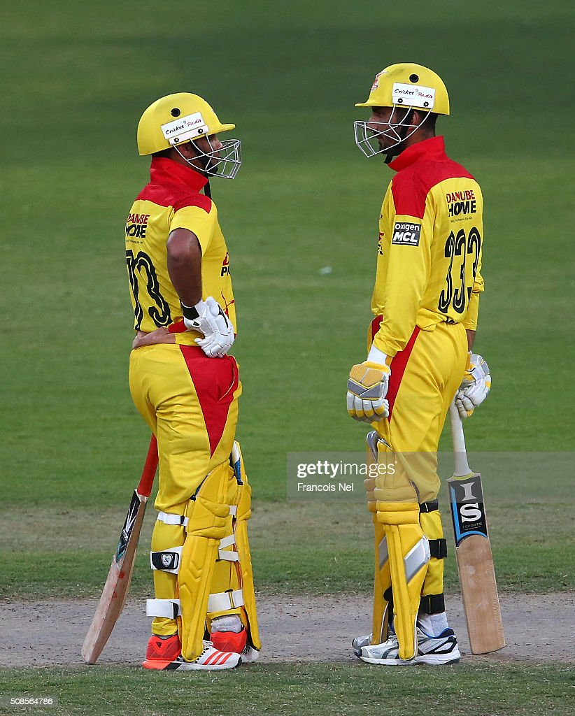 Imran Farhat of Sagittarius confers with Yasir Hameed during the Oxigen Masters Champions League match between Sagittarius Strikers and Gemini Arabians on February 5, 2016 in Sharjah, United Arab Emirates.