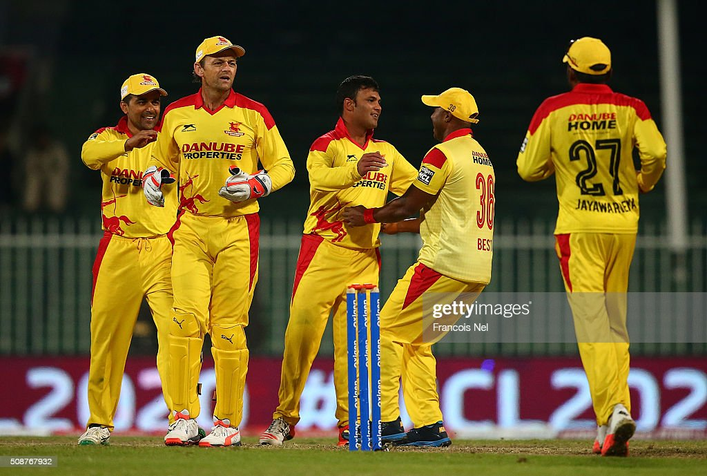 Imran Farhat of Sagittarius Strikers celebrates the wicket of Brendan Taylor of Leo Lions with his team-mates during the Oxigen Masters Champions League match between Leo Lions and Sagittarius Strikers on February 6, 2016 in Sharjah, United Arab Emirates.