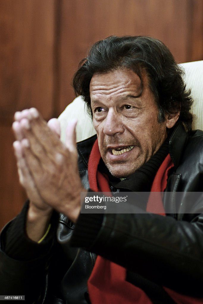 <a gi-track='captionPersonalityLinkClicked' href=/galleries/search?phrase=Imran+Khan+-+Politician&family=editorial&specificpeople=13488792 ng-click='$event.stopPropagation()'>Imran Khan</a>, chairman of Pakistan Tehreek-e-Insaf, gestures as he speaks during an interview in Islamabad, Pakistan, on Thursday, Feb. 06, 2014. Pakistan peace talks with Taliban militants will probably fail and an ensuing military operation would lead to more terrorism, according to Khan. Photographer: Asad Zaidi/Bloomberg via Getty Images