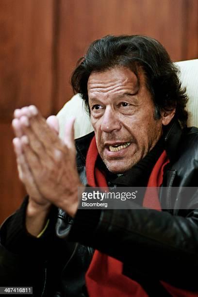 Imran Khan chairman of Pakistan TehreekeInsaf gestures as he speaks during an interview in Islamabad Pakistan on Thursday Feb 06 2014 Pakistan peace...
