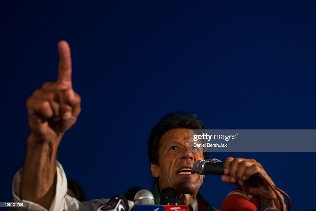 <a gi-track='captionPersonalityLinkClicked' href=/galleries/search?phrase=Imran+Khan+-+Politician&family=editorial&specificpeople=13488792 ng-click='$event.stopPropagation()'>Imran Khan</a>, chairman of the Pakistan Tehrik e Insaf (PTI) party, addresses supporters during an election campaign rally on May 05, 2013 in Faisalabad, Pakistan. Pakistan's parliamentary elections are due to be held on May 11. <a gi-track='captionPersonalityLinkClicked' href=/galleries/search?phrase=Imran+Khan+-+Politician&family=editorial&specificpeople=13488792 ng-click='$event.stopPropagation()'>Imran Khan</a> of Pakistan Tehrik e Insaf (PTI) and Nawaz Sharif of the Pakistan Muslim League-N (PMLN) have been campaigning hard in the last weeks before polling.