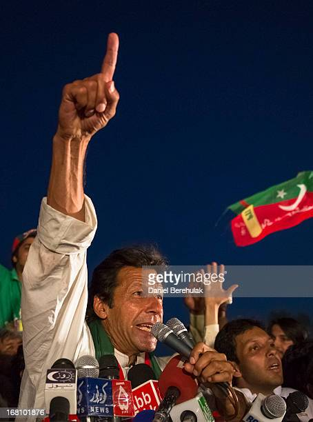 Imran Khan chairman of the Pakistan Tehrik e Insaf party addresses supporters during an election campaign rally on May 05 2013 in Faisalabad Pakistan...