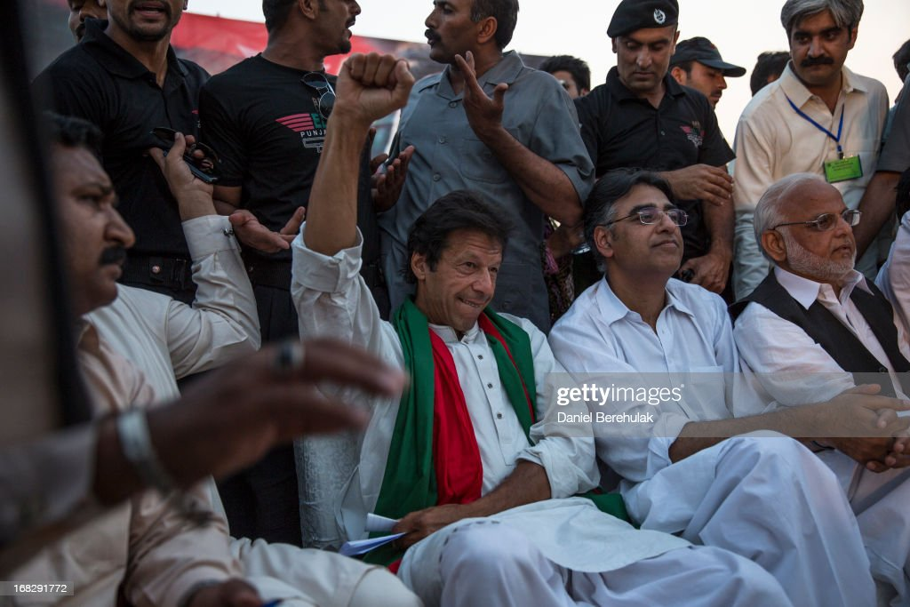 Imran Khan, chairman of the Pakistan Tehrik e Insaf (PTI) party, pumps his fist before addressing supporters during an election campaign rally on May 05, 2013 in Faisalabad, Pakistan. Pakistan's parliamentary elections are due to be held on May 11. Imran Khan of Pakistan Tehrik e Insaf (PTI) and Nawaz Sharif of the Pakistan Muslim League-N (PMLN) have been campaigning hard in the last weeks before polling.