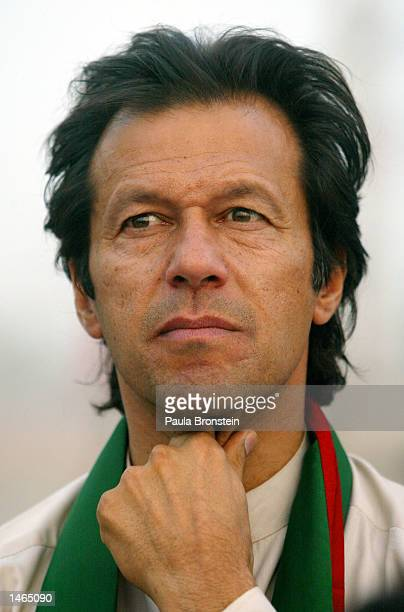 Imran Khan cricket captain turned politician and chairman of the Dhirir TehrikeInsaf political party attends a rally October 8 2002 in Shadi Khal...