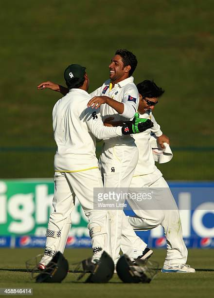 Imran Khan of Pakistan is congratulated by his team mates after bowling Corey Anderson of New Zealand lbw during day four of the first test between...
