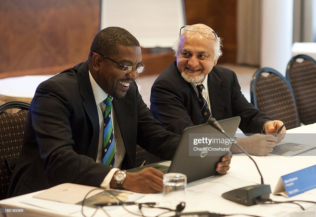 Imran Khwaja of Singapore shares a joke with West Indies Dave Cameron during the ICC Board Meeting at The Royal Garden Hotel on October 18, 2013 in London, England.