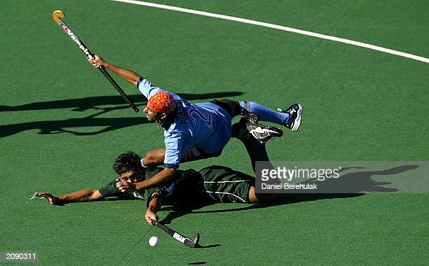 Imran Rasool of Pakistan lunges for the ball ahead of Prabjot Singh of India during the Hockey Australia Men's Challenge June 7 2003 at the the...