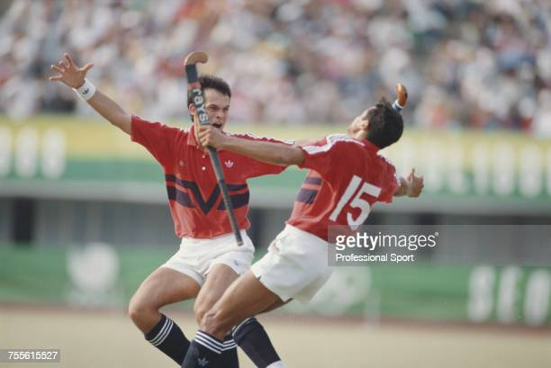 Imran Sherwani of the Great Britain field hockey team celebrates with a teammate after scoring Great Britain's third goal to beat West Germany 31 in...