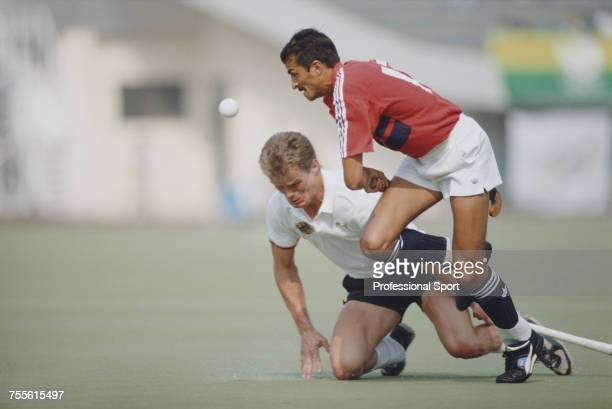 Imran Sherwani of the Great Britain field hockey team pictured in action as he advances past a West Germany player during play to beat West Germany...