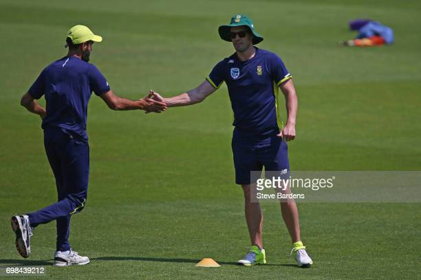 Imran Tahir and AB de Villiers of South Africa shake hands during a South Africa nets session ahead of the Twenty20 International between England and...