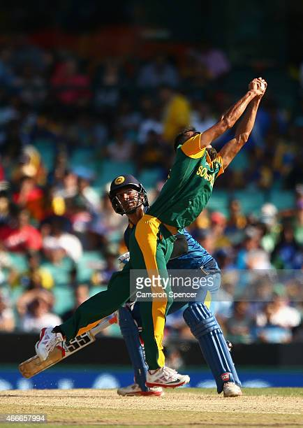 Imran Tahir of South Africa catches out Lahiru Thirimanne of Sri Lanka during the 2015 ICC Cricket World Cup match between South Africa and Sri Lanka...