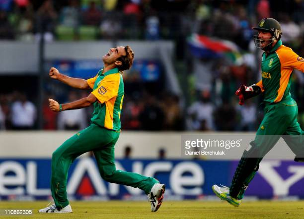 Imran Tahir of South Africa celebrates after taking the wicket of Jesse Ryder of New Zealand during the 2011 ICC World Cup QuarterFinal match between...