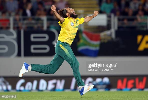 TOPSHOT Imran Tahir of South Africa celebrates after taking the wicket of Luke Ronchi of New Zealand during the Twenty20 international cricket match...