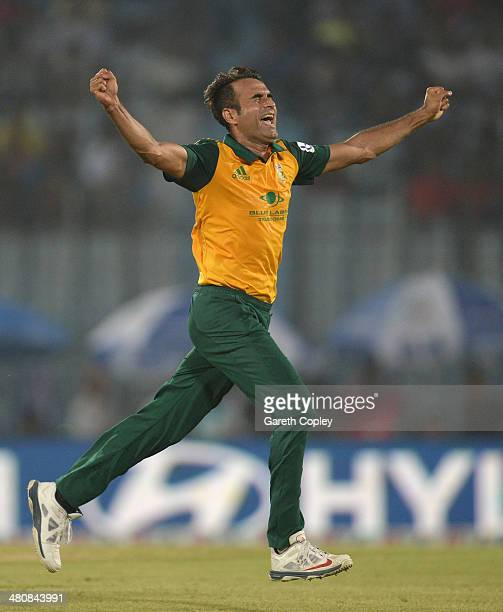 Imran Tahir of South Africa celebrates dismissing Tom Cooper of the Netherlands during the ICC World Twenty20 Bangladesh 2014 Group 1 match between...