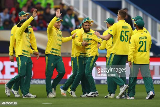Imran Tahir of South Africa celebrates taking a catch off the bowling of Morne Morkel to dismiss Mohammad Hafeez of Pakistan during the ICC Champions...