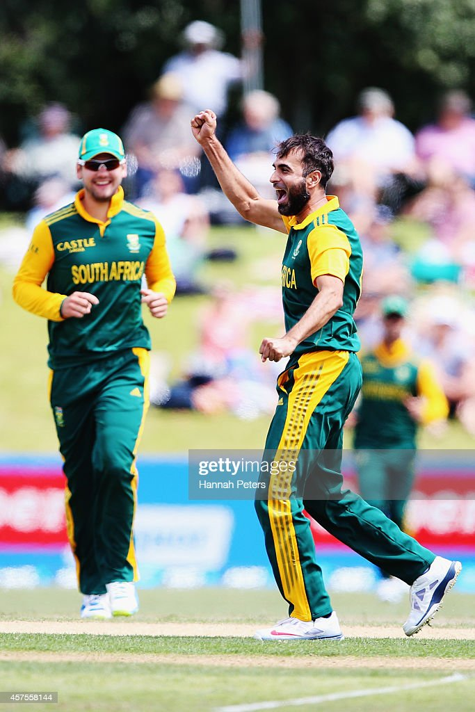Imran Tahir of South Africa celebrates the wicket of Daniel Vettori of New Zealand during the One Day International match between New Zealand and South Africa at Bay Oval on October 21, 2014 in Mount Maunganui, New Zealand.