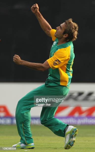 Imran Tahir of South Africa celebrates the wicket of David Hussey of Australia during the 2011 ICC World Cup warm up game between South Africa and...