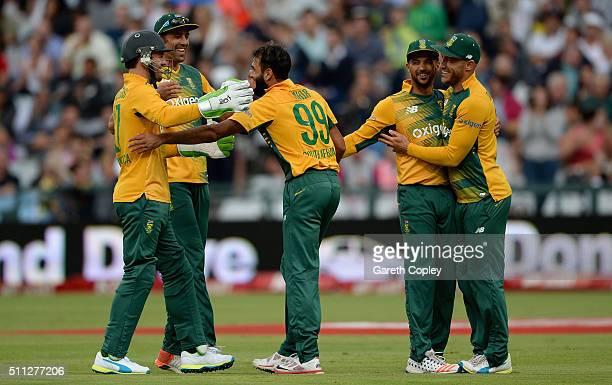 Imran Tahir of South Africa celebrates with teammates after dismissing Moeen Ali of England during the 1st KFC T20 International match between South...