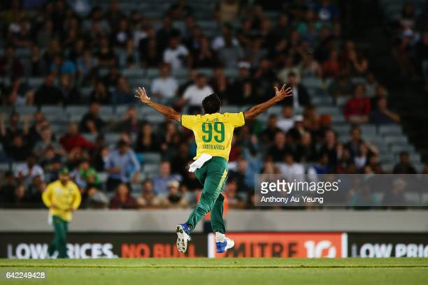 Imran Tahir of South Africa celebrates with teammates for the wicket of Tim Southee of New Zealand during the first International Twenty20 match...