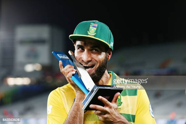 Imran Tahir of South Africa celebrates with the T20 trophy after winning the first International Twenty20 match between New Zealand and South Africa...