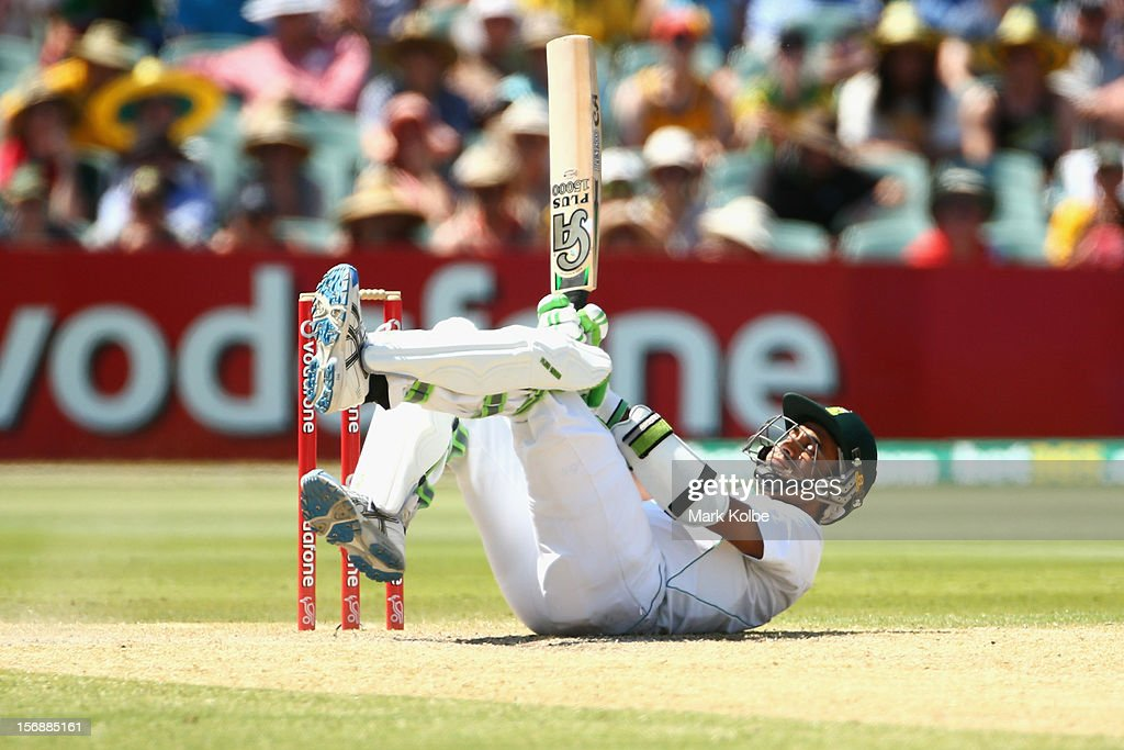<a gi-track='captionPersonalityLinkClicked' href=/galleries/search?phrase=Imran+Tahir&family=editorial&specificpeople=2128968 ng-click='$event.stopPropagation()'>Imran Tahir</a> of South Africa falls as he evades a short ball which batting during day three of the Second Test Match between Australia and South Africa at Adelaide Oval on November 24, 2012 in Adelaide, Australia.