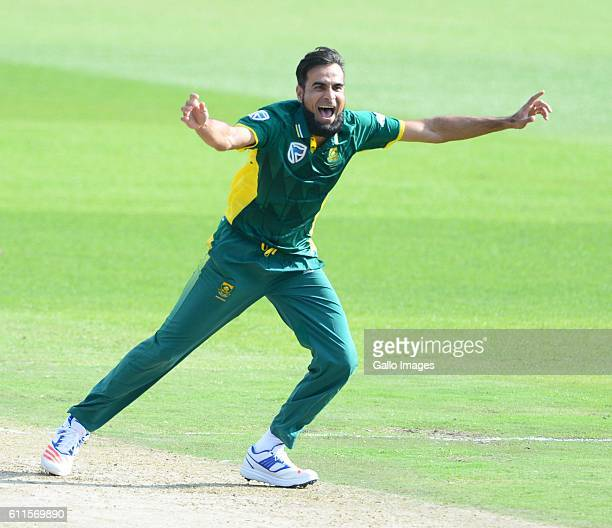 Imran Tahir of the Proteas celebrates the wicket of Travis Head of Australia during the 1st Momentum ODI Series match between South Africa and...