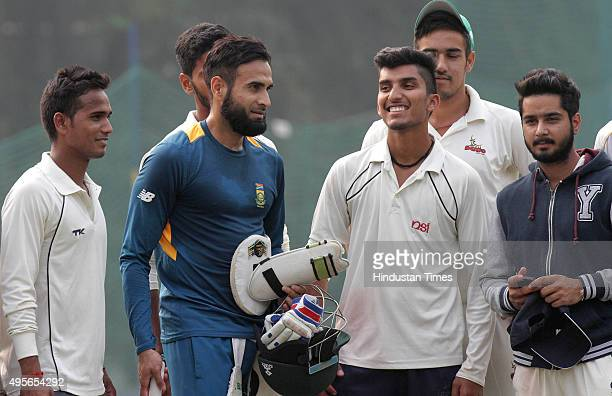 Imran Tahir player of South Africa cricket team interacting with budding cricketers of Mohali cricket club during the net practice before the...