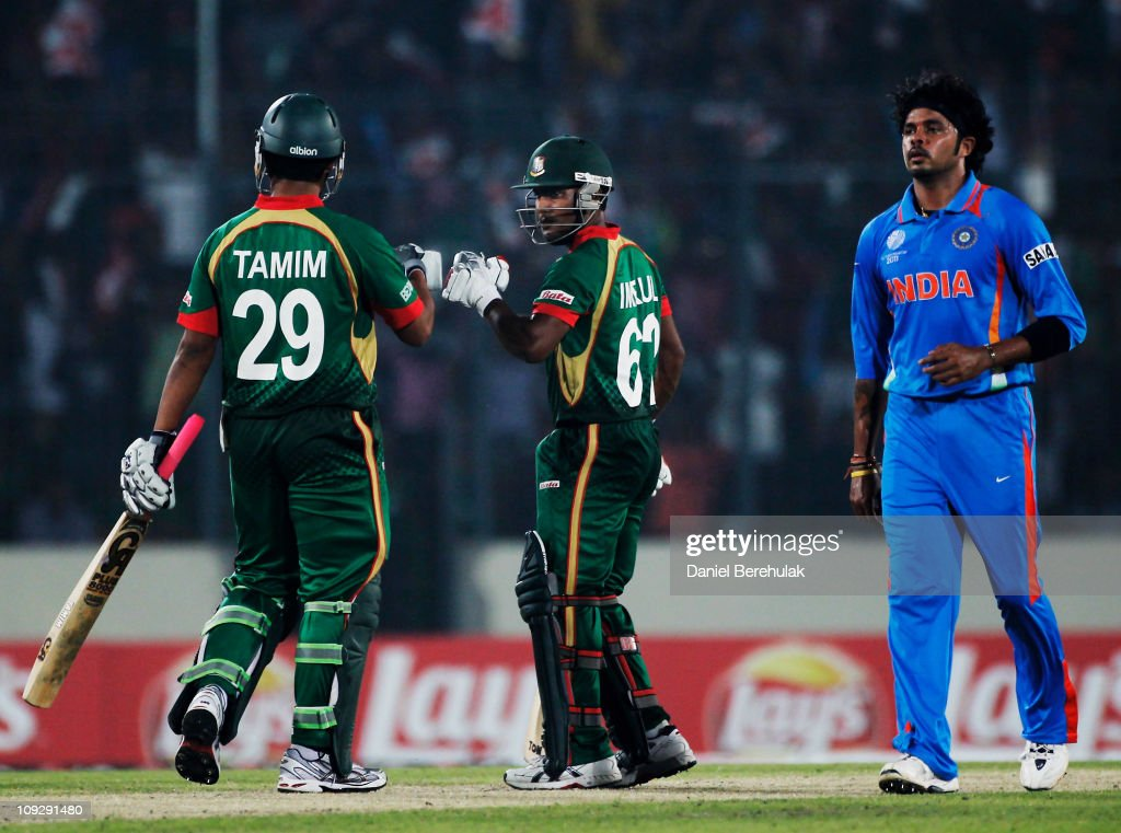 Imrul Kayes of Bangladesh celebrates with team mate Tamim Iqbal, as bowler Shanthakumaran Sreesanth of india looks onwards during the opening game of the ICC Cricket World Cup between Bangladesh and India at the Shere-e-Bangla National Stadium on February 19, 2011 in Dhaka, Bangladesh.